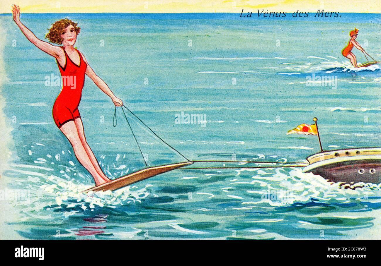 France - la Vénus des mers - une jeune femme en maillot de bain rouge qui profite du ski nautique. Vers 1930 Banque D'Images