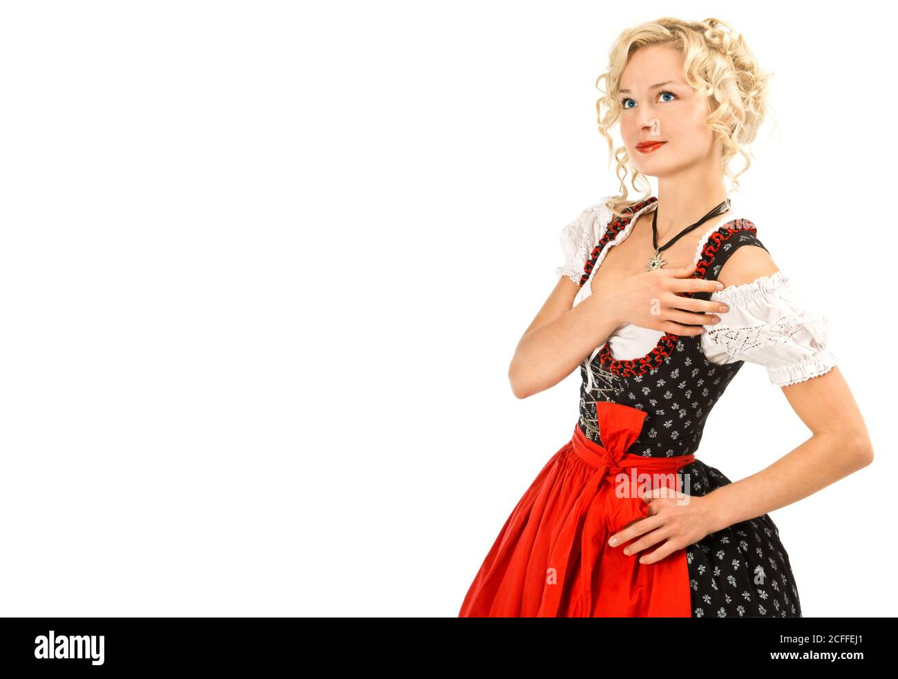 Jeune femme allemande dans la traditionnelle oktoberfest robe dirndl Banque D'Images