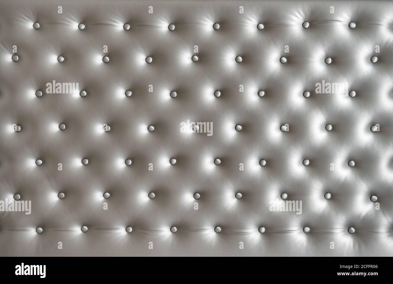 Fond gris satiné avec boutons. Texture en soie Banque D'Images