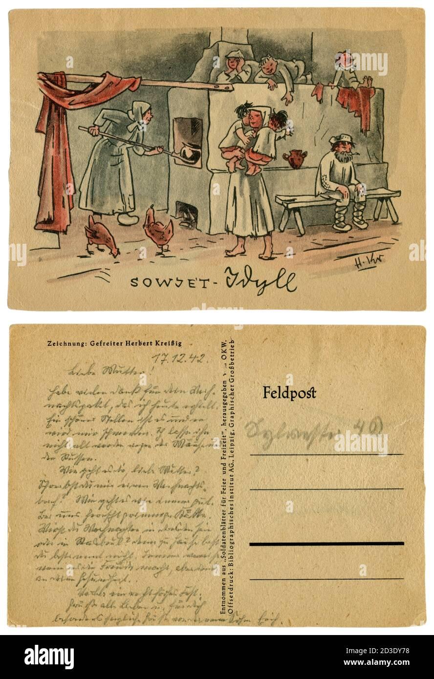Carte postale historique allemande : 'Soviet idylll'. Caricature d'une grande famille avec des enfants à l'intérieur d'une cabane, près d'un poêle russe, Union soviétique, 1941 Banque D'Images