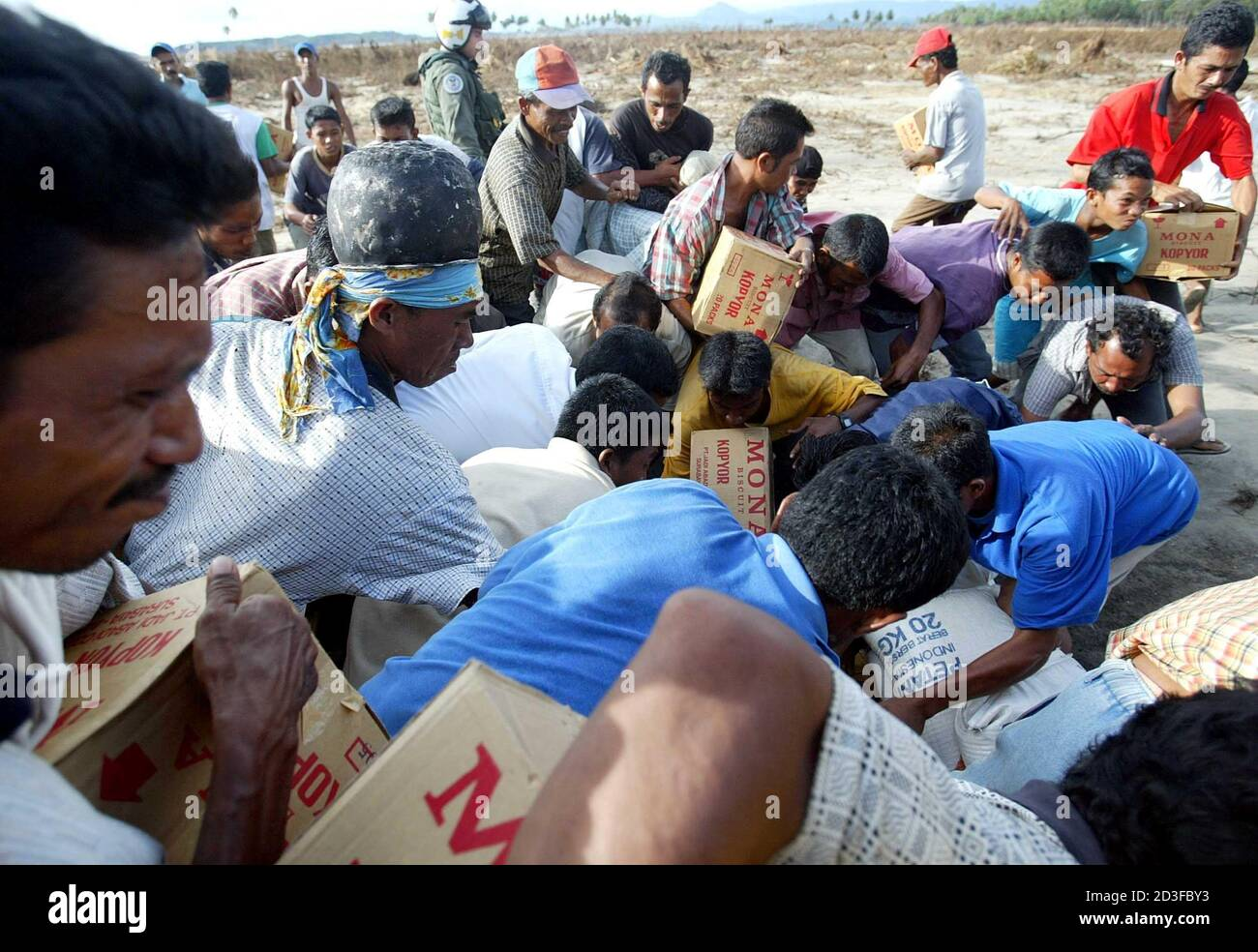 Tsunami Victims Fight For Their Boxes Of Relief Supplies Provided By U S Military In Lamno South Of Banda Aceh Tsunami Victims Fight For Their Boxes Of Relief Supplies Provided By Usns Rainier S