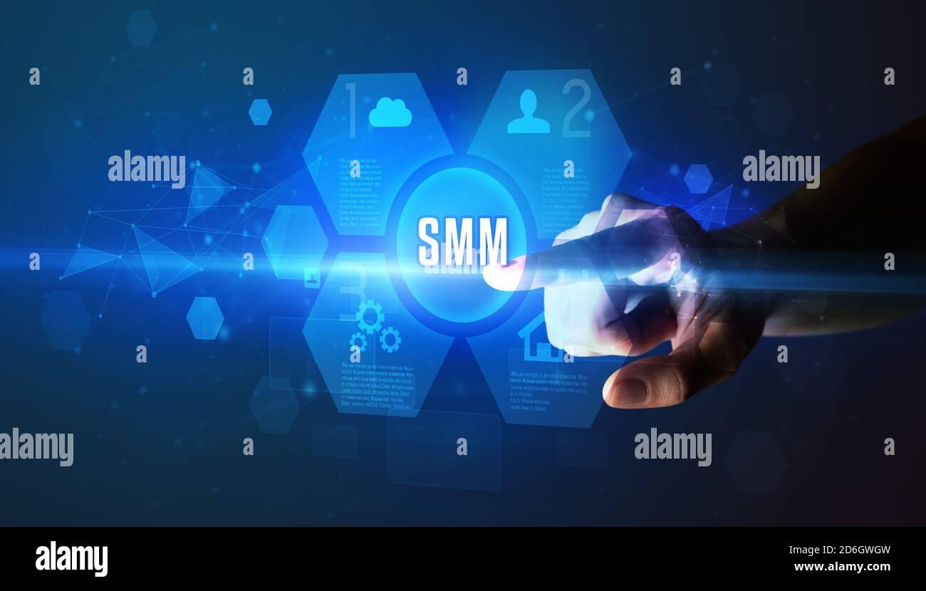 Hand touching SMM inscription, nouvelle technologie concept Banque D'Images