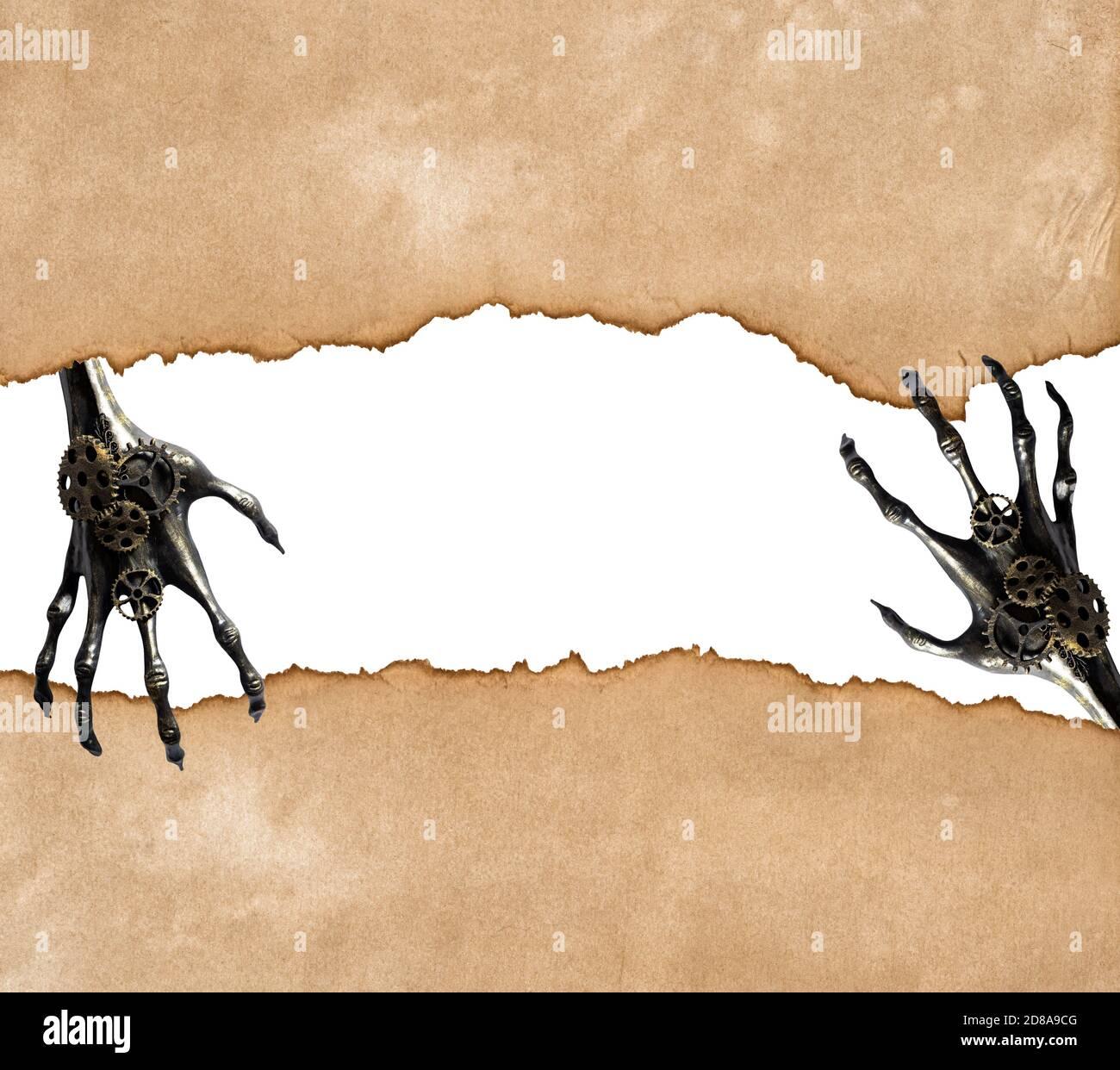 Arrière-plan de Halloween. Papier déchiré avec des mains de squelette Banque D'Images