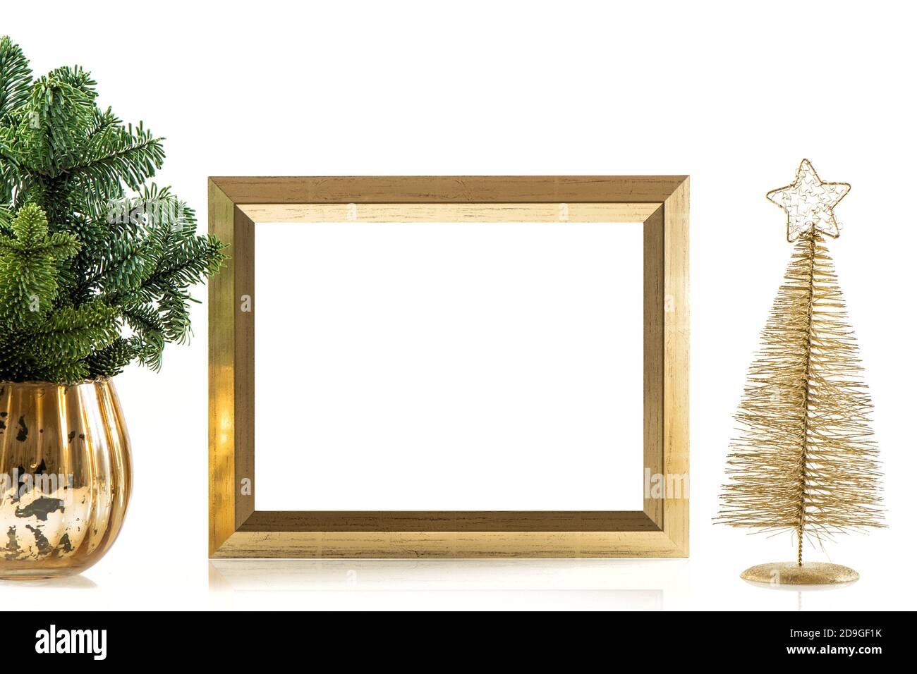 Cadre photo doré et décoration de Noël Banque D'Images