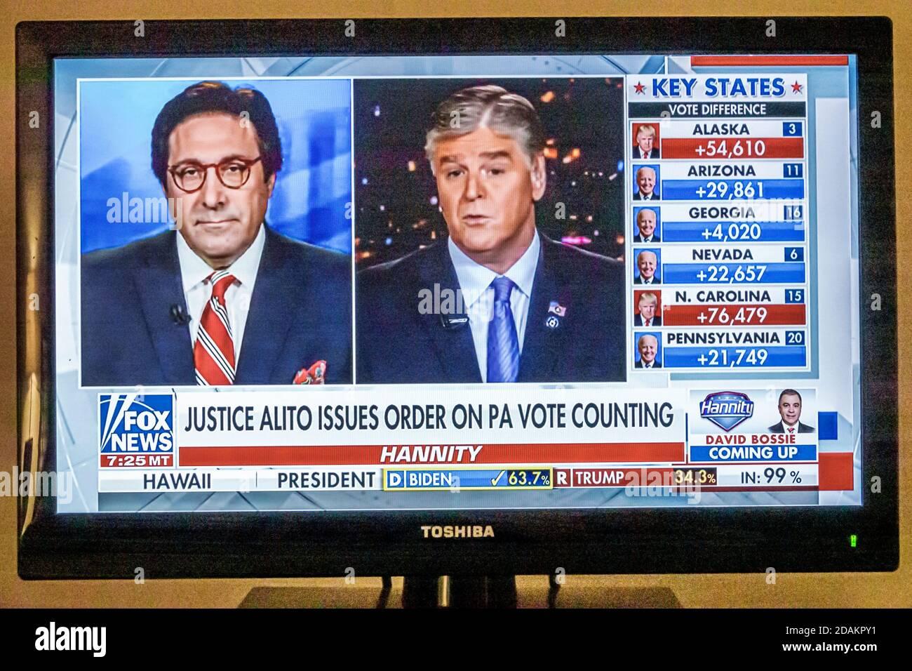 Télévision câblée écran de télévision moniteur 2020 des résultats de l'élection présidentielle américaine Joe Biden Donald Trump vote le nombre de votes populaires au collège électoral ou non autorisé Banque D'Images