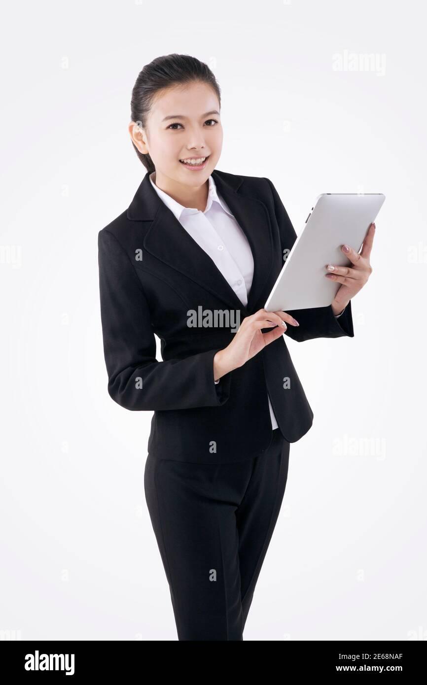Femme d'affaires de mode orientale et IPAD photo de haute qualité Banque D'Images
