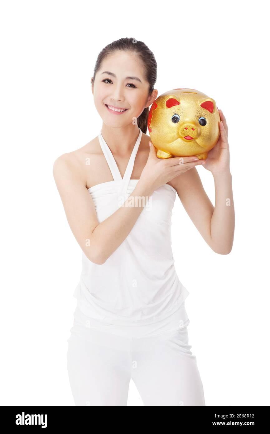 La jeune femme à la mode et la banque de porc photo de haute qualité Banque D'Images