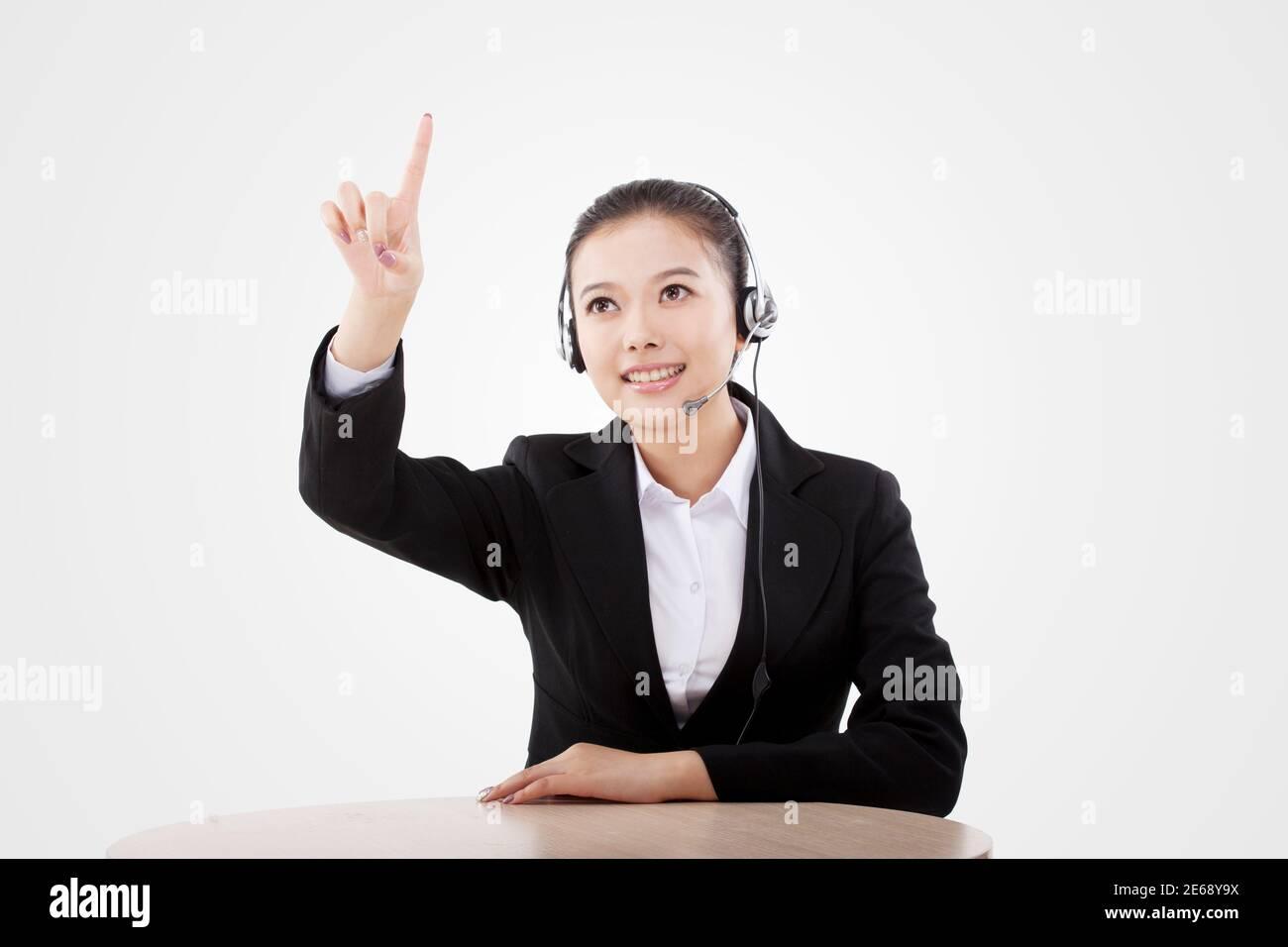 Femme d'affaires orientale portant un casque photo de haute qualité Banque D'Images