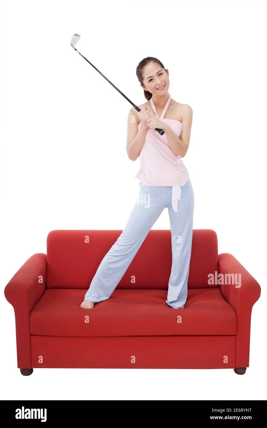 Femme de mode orientale avec un club de golf photo de haute qualité Banque D'Images