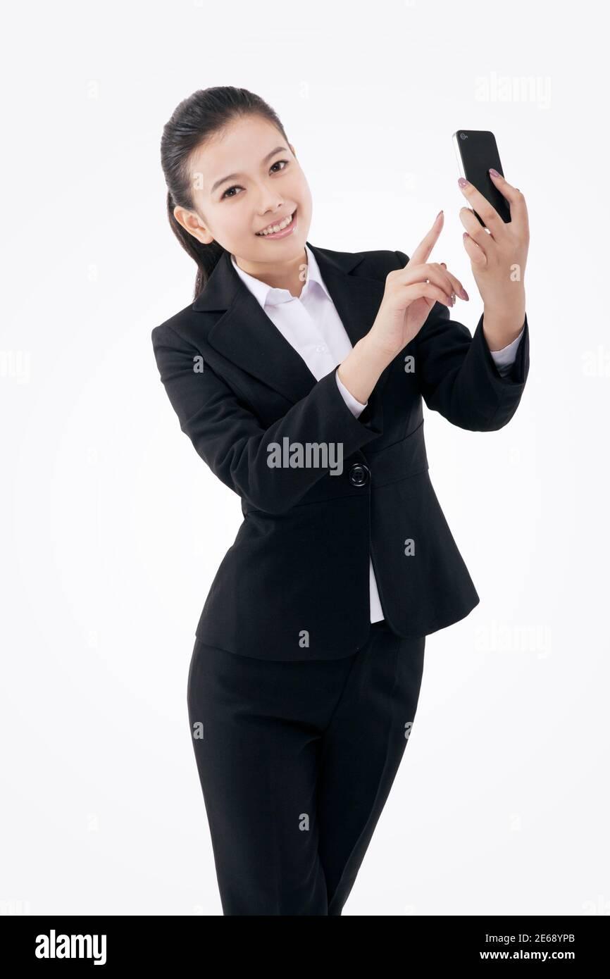 Femme d'affaires de mode orientale appelant photo de haute qualité Banque D'Images
