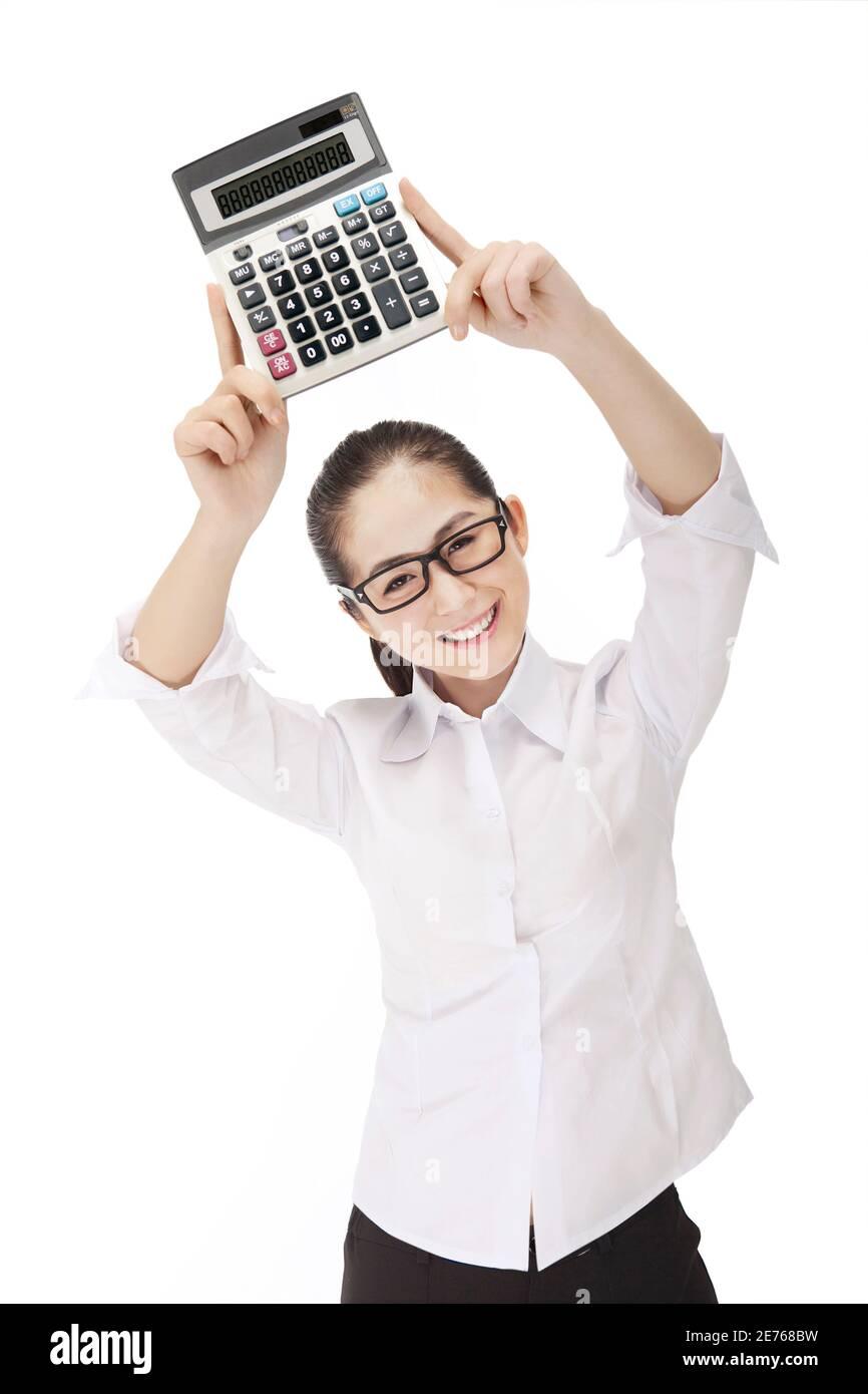 Femme d'affaires avec calculatrice photo de haute qualité Banque D'Images
