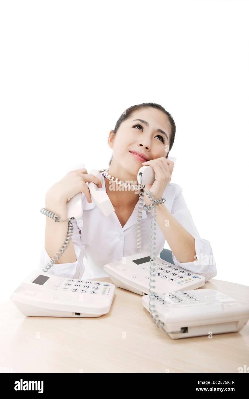 Femme d'affaires et trois téléphones photo de haute qualité Banque D'Images