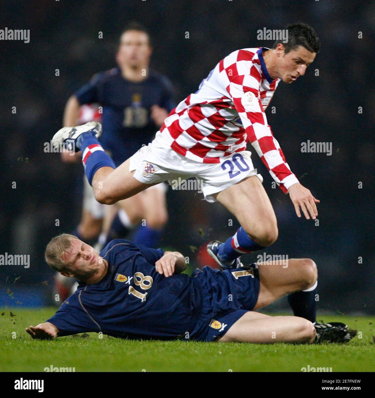 Scotland's James McEvely (18) tackles Croatia's Igor Budan (20) during their international soccer match at Hampden Park stadium in Glasgow, Scotland March 26, 2008.  REUTERS/David Moir (BRITAIN) Banque D'Images