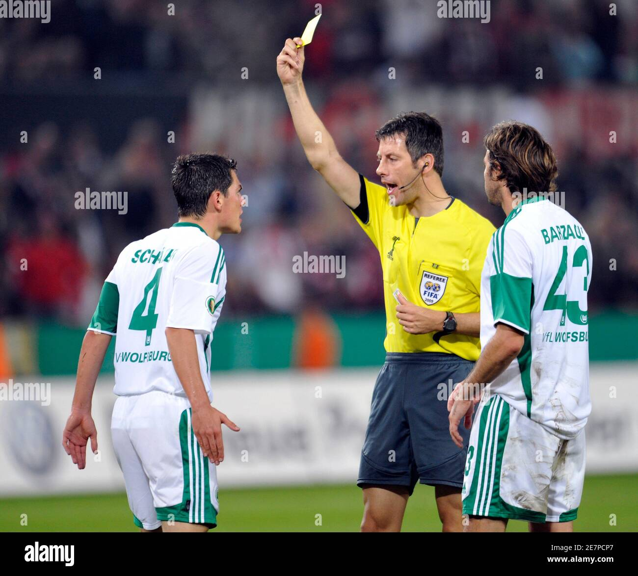 VFL Wolfsburg's Marcel Schaefer is sent off the pitch by referee ...