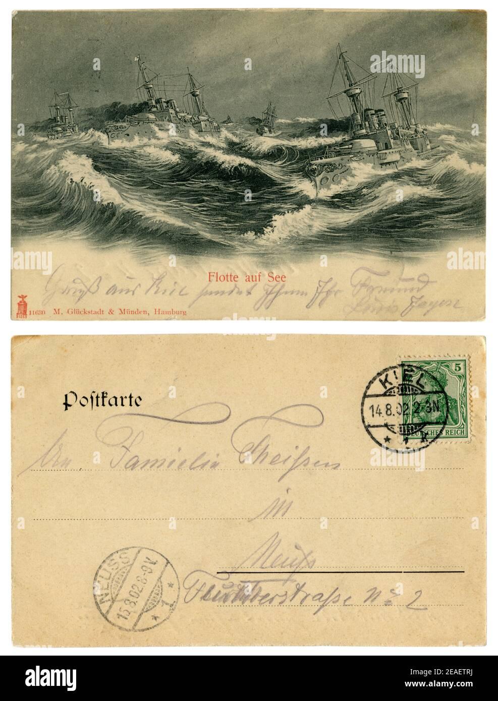 Carte postale historique allemande : navires de guerre de la Marine impériale allemande (kaisermarine) dans une mer agitée, signée en crayon violet, arrière, Allemagne, 1902 Banque D'Images