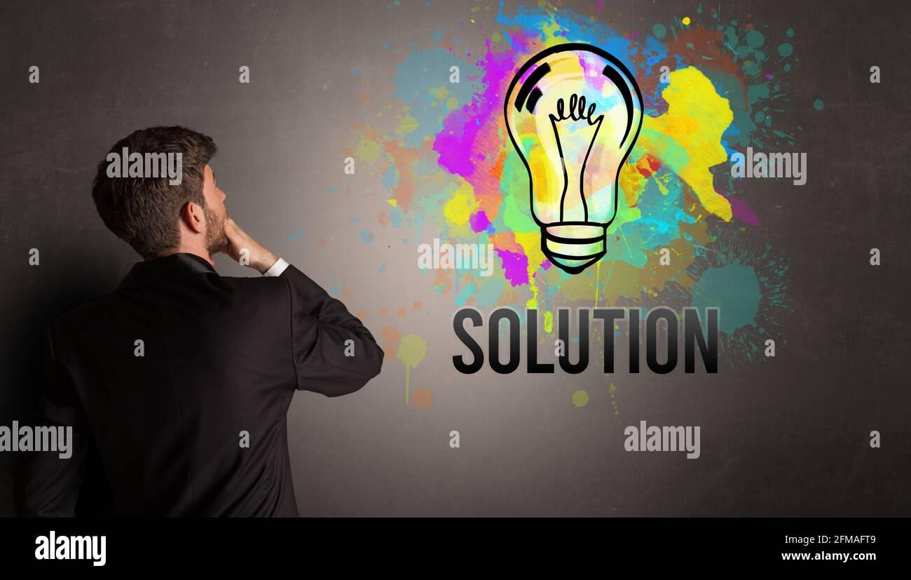 homme d'affaires dessin ampoule colorée Banque D'Images