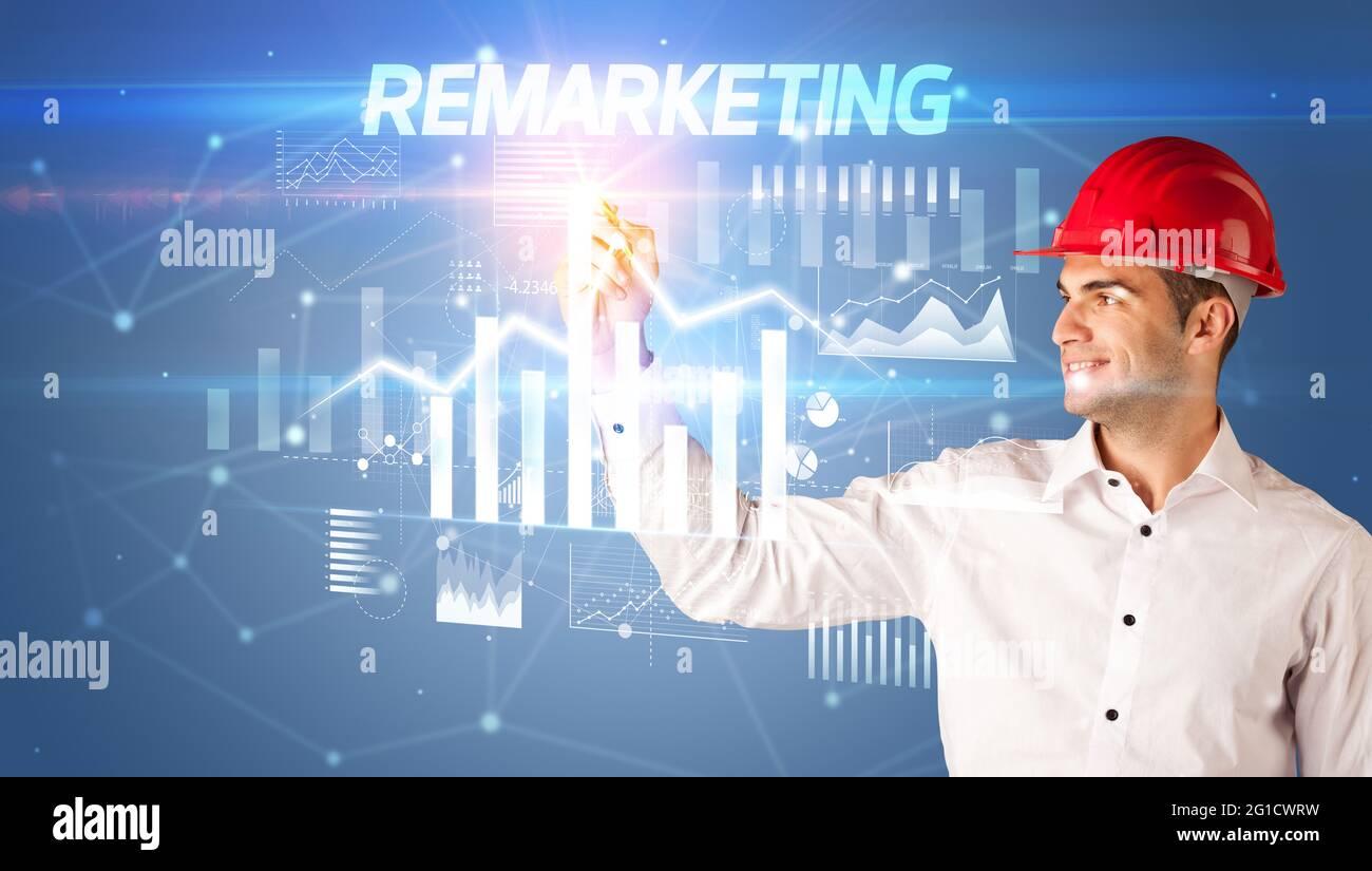 Jeune homme d'affaires avec un casque tirant sur écran virutal Banque D'Images