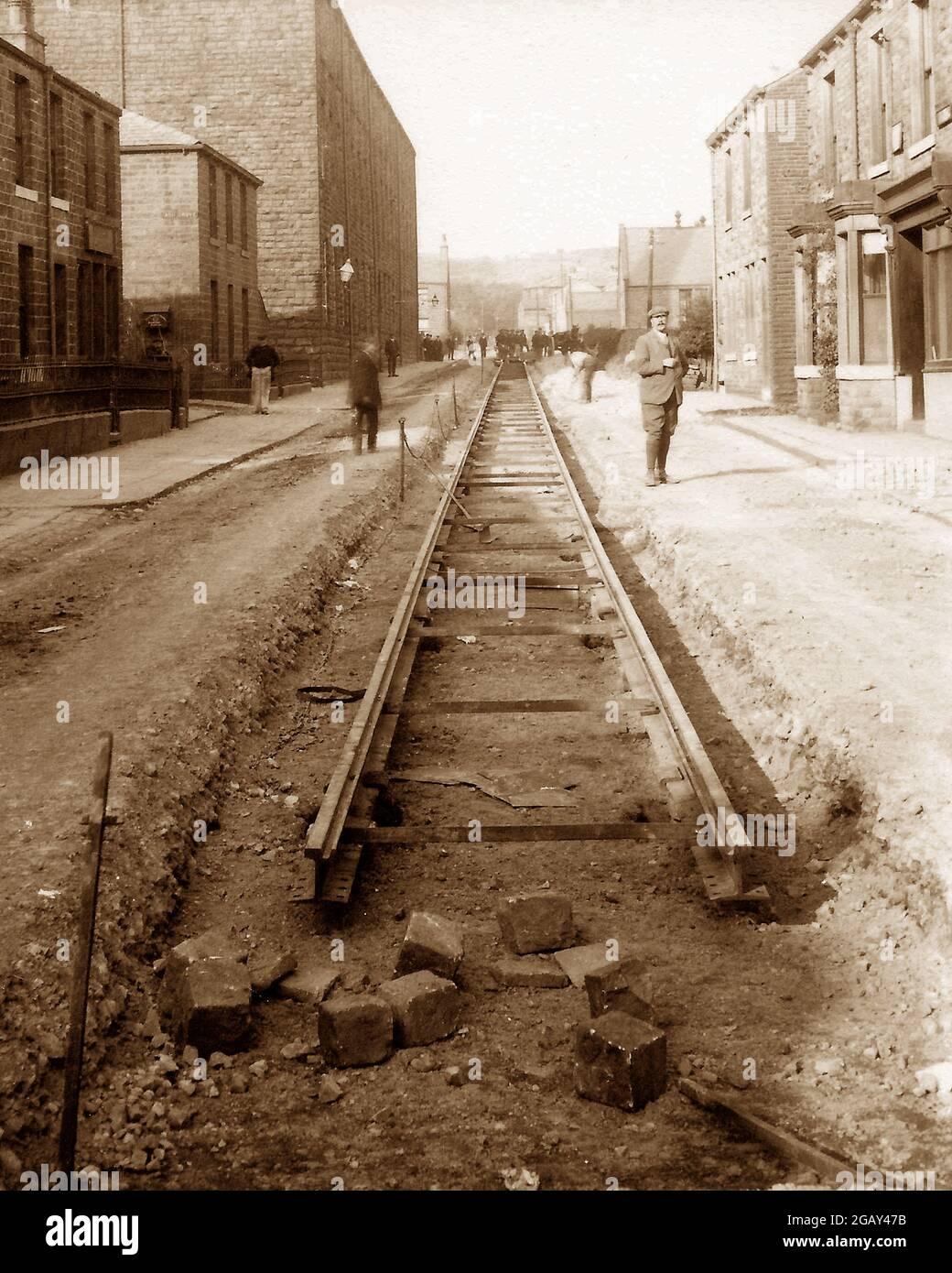 Pose de voies de tramway à Water, début 1900 Banque D'Images