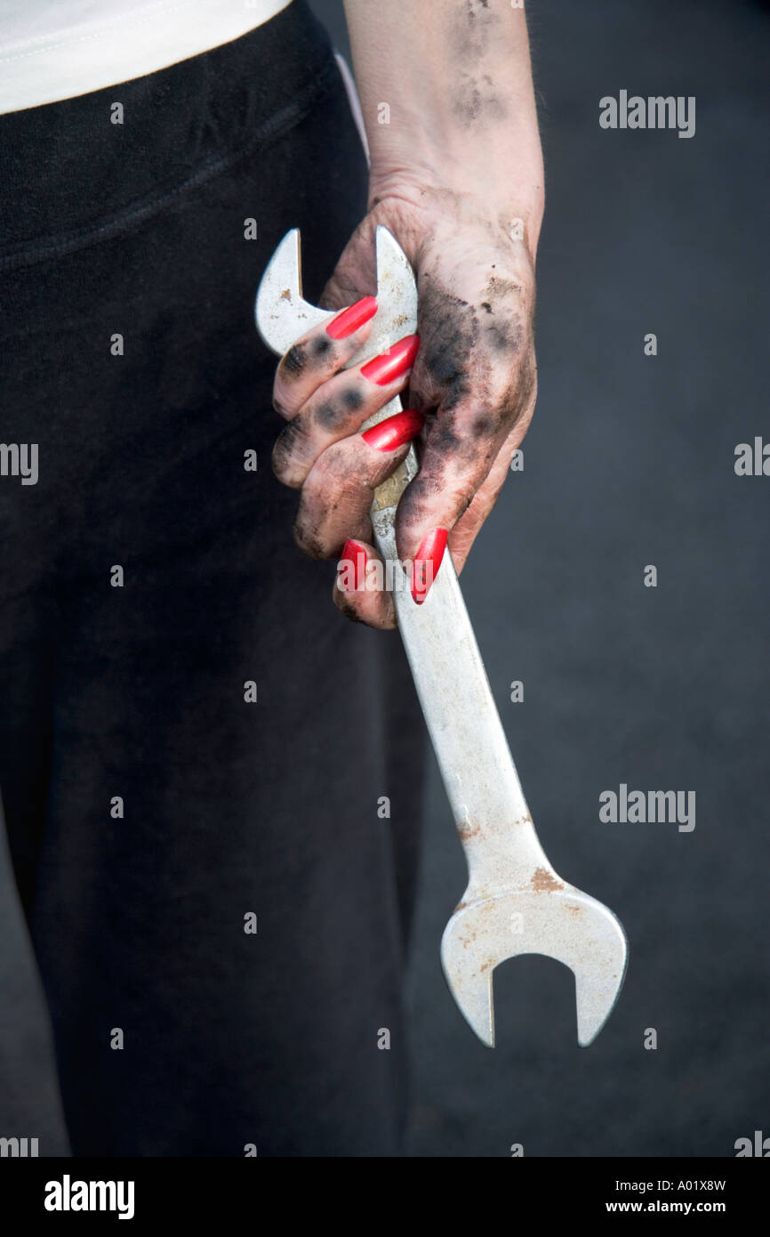 Woman holding spanner close up Photo Stock