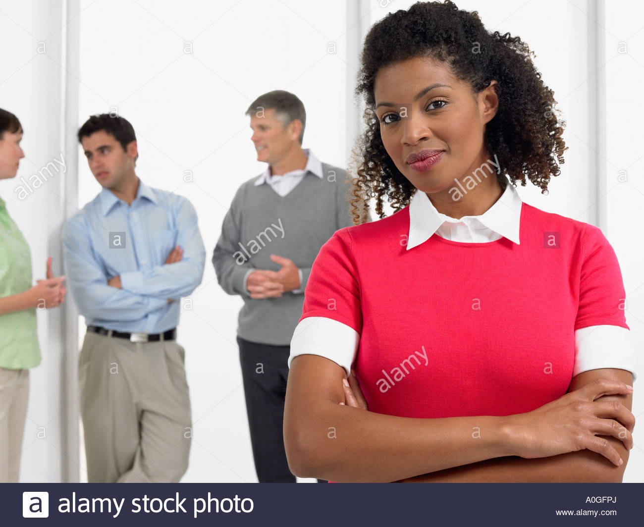 Female office worker with arms crossed Photo Stock