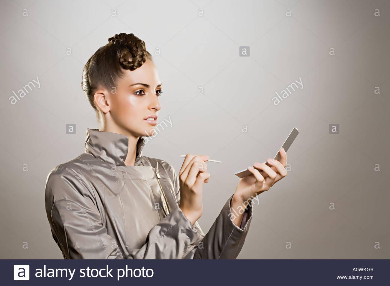 Femme avec electronic organizer Photo Stock
