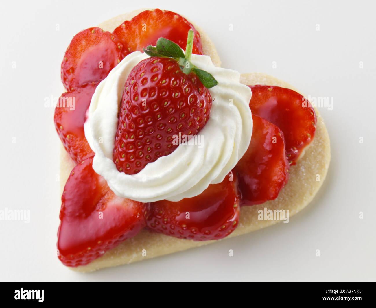 Valentine aux fraises en forme de coeur Photo Stock