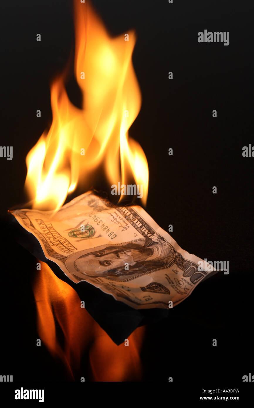 De l'argent avec des flammes Photo Stock