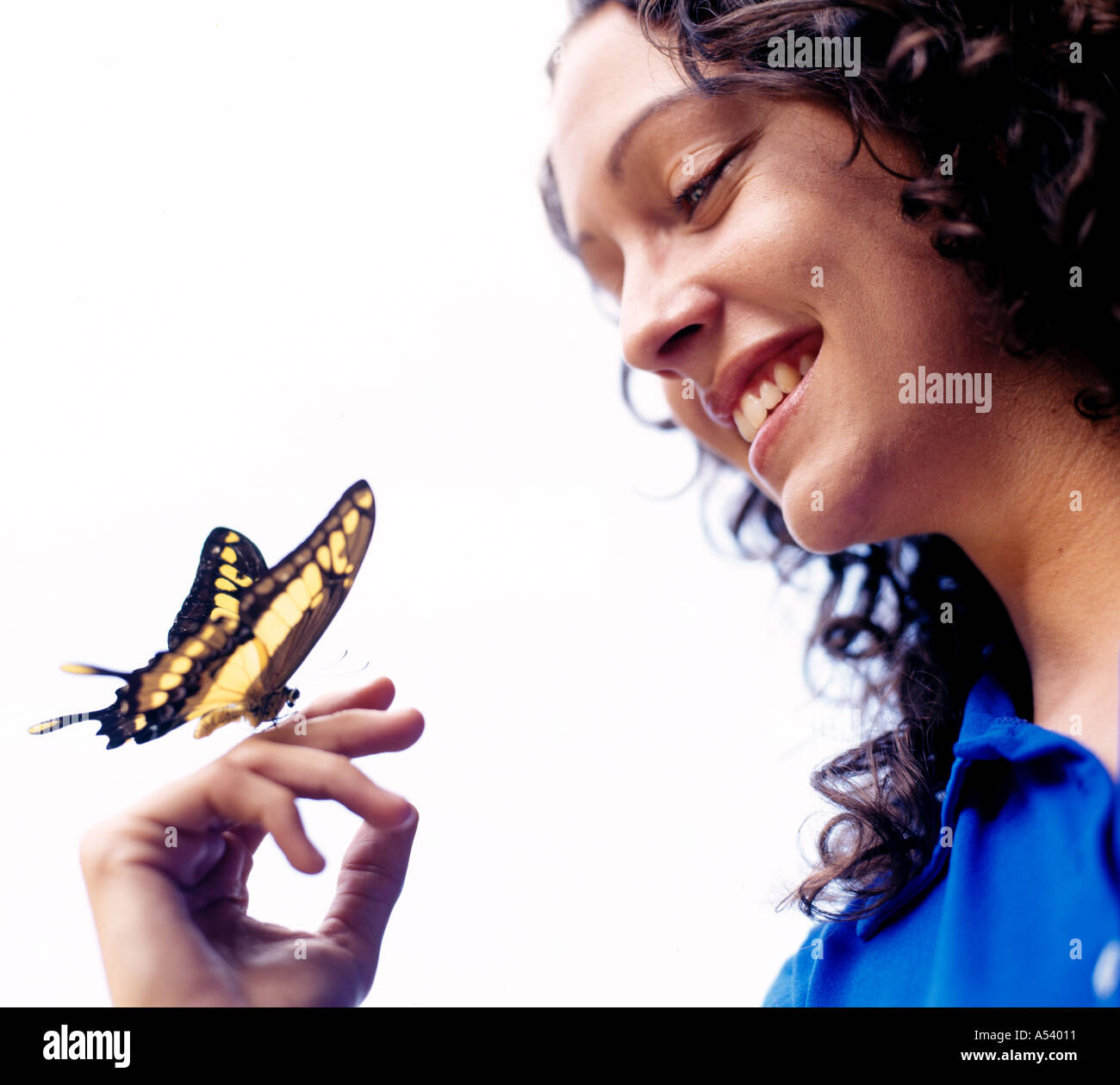 Woman with butterfly on hand Photo Stock