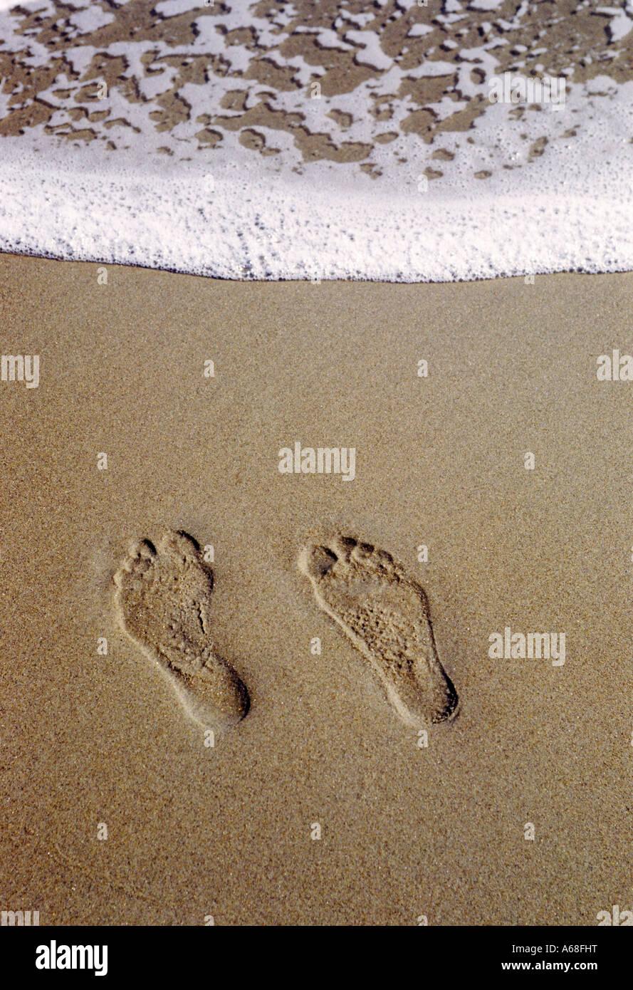 Empreintes de pieds dans le sable Photo Stock