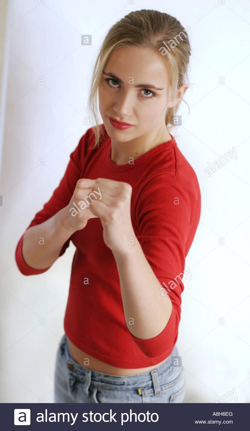 Femme d'élever ses poings dans la réussite Photo Stock