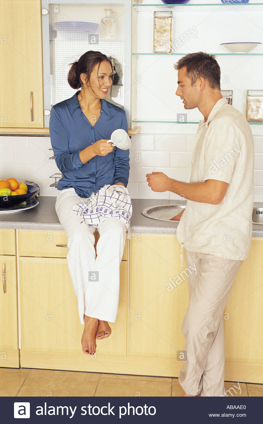 Couple in kitchen Photo Stock