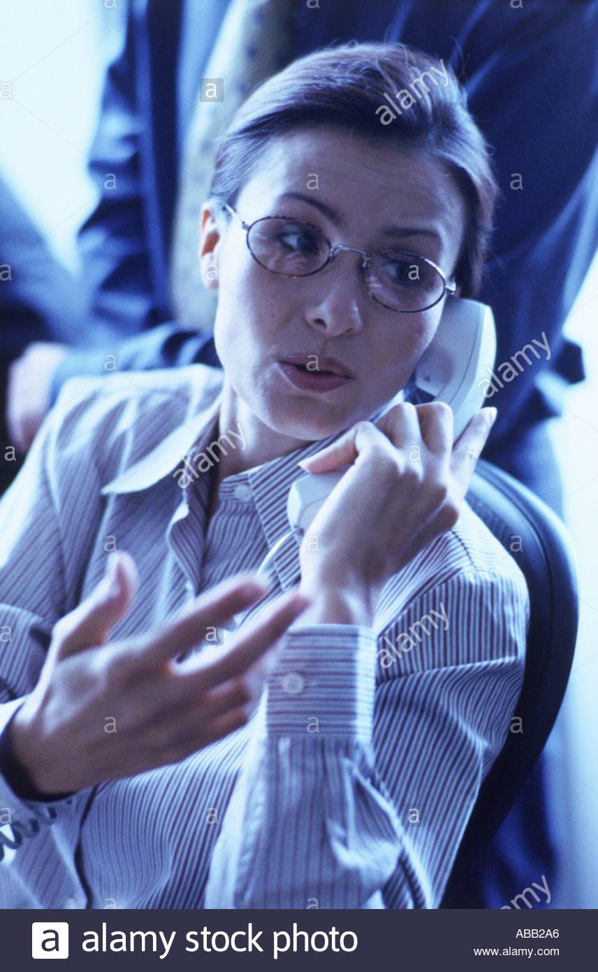 Businesswoman using telephone Photo Stock