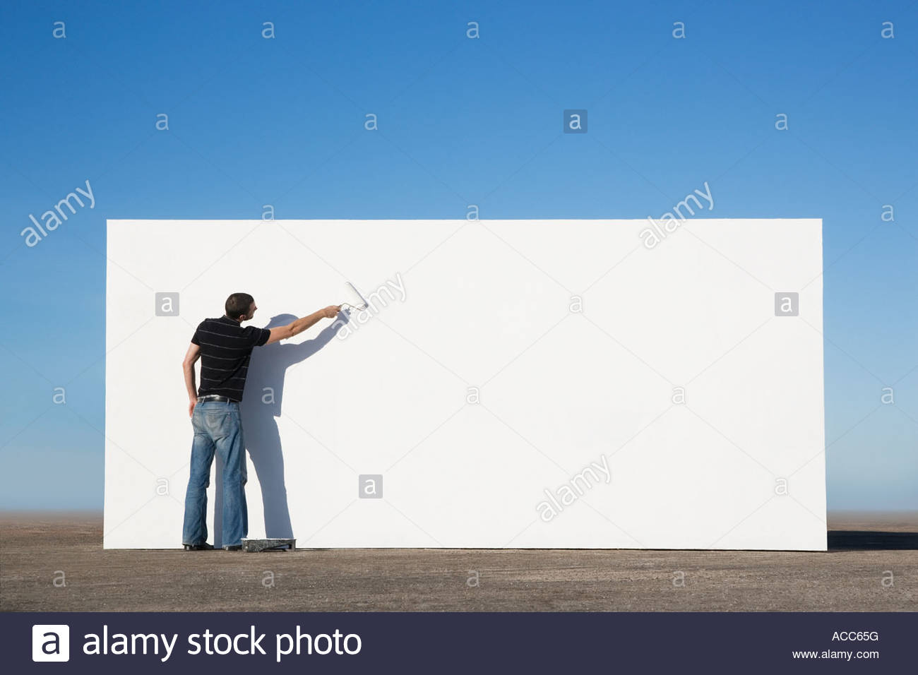 Man painting wall outdoors Photo Stock