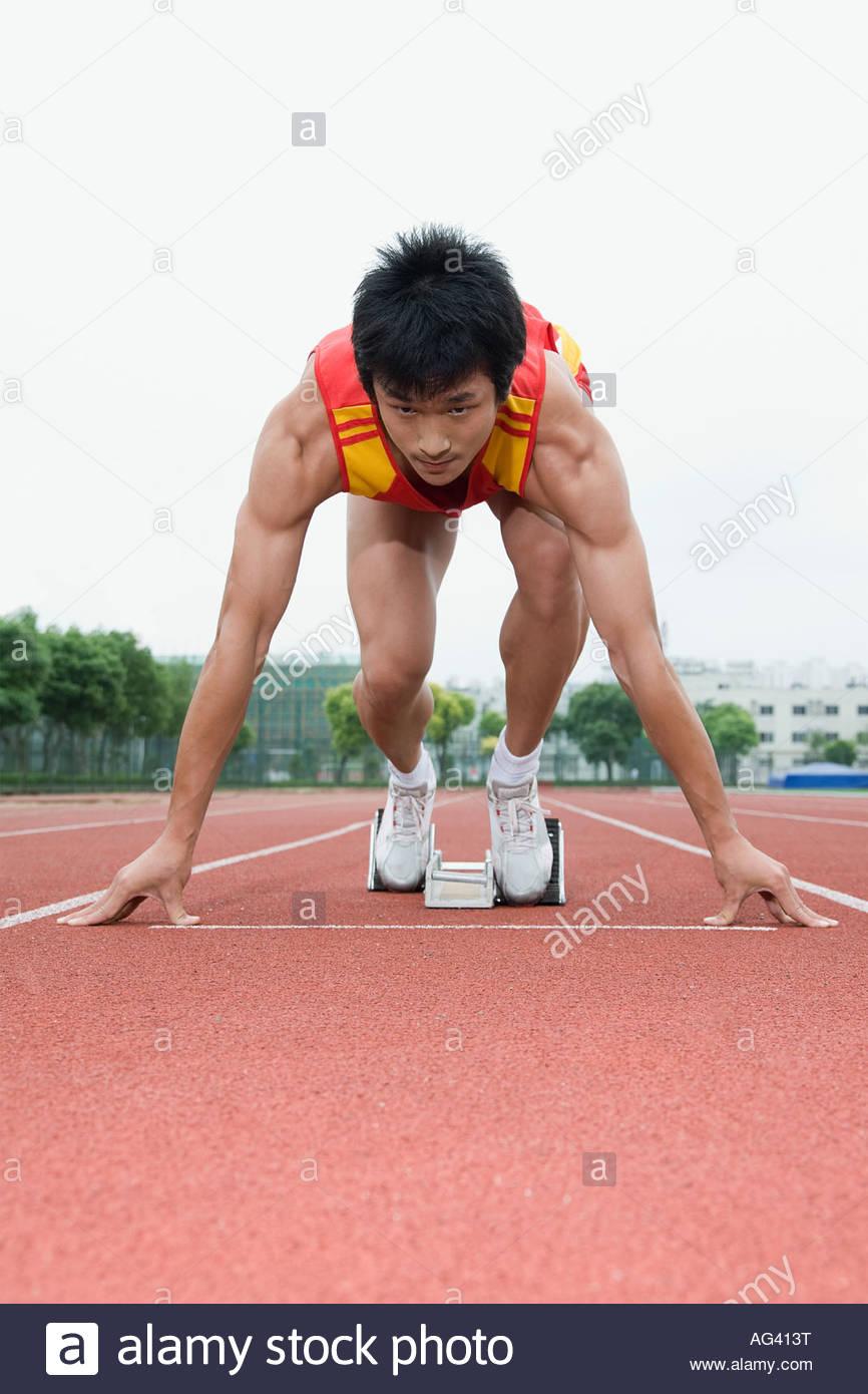 Sur ligne de départ de l'athlète Photo Stock