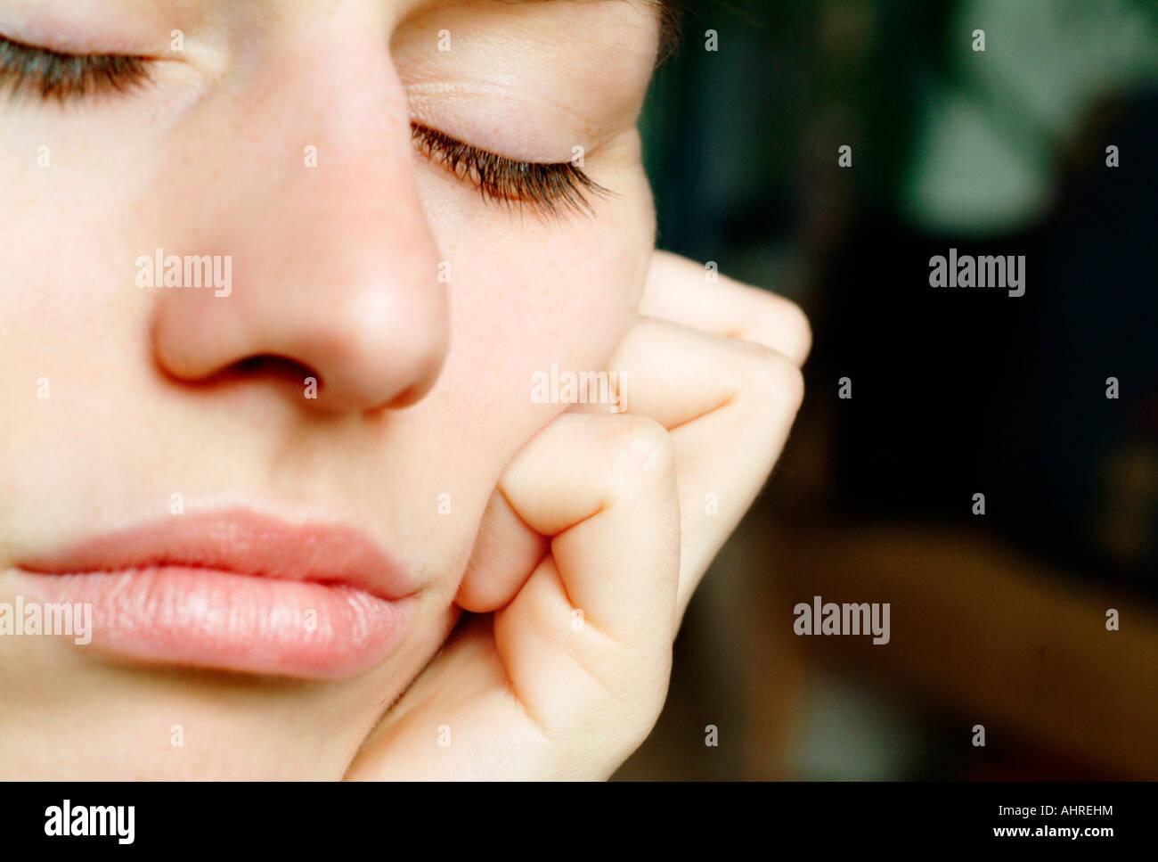 Visage d'une jeune femme Photo Stock