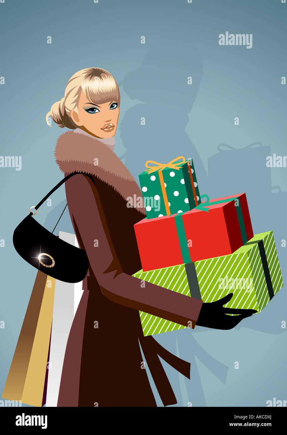 Portrait d'une femme portant des cadeaux de Noël Photo Stock