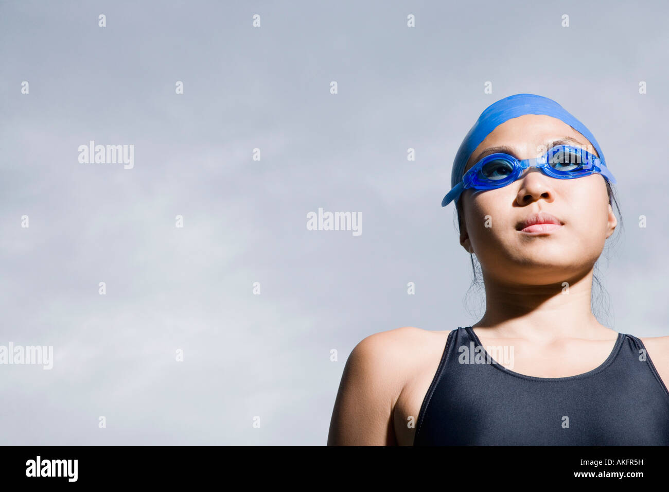 Close-up of a young woman wearing lunettes de natation Photo Stock
