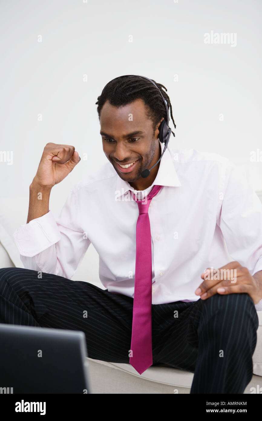 African businessman cheering at laptop Banque D'Images