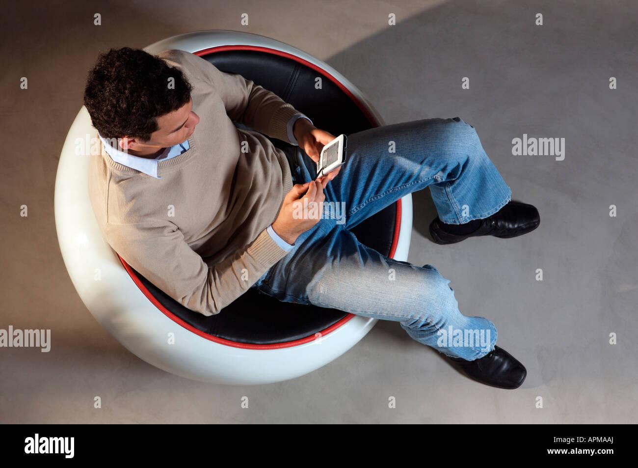Homme à l'agenda électronique Photo Stock