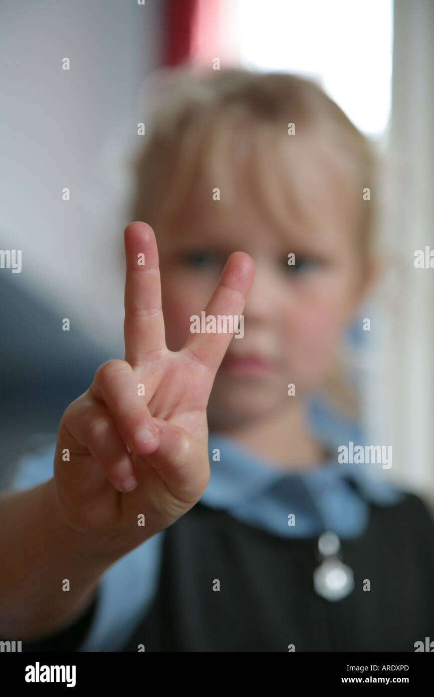 Young Girl making peace sign Photo Stock