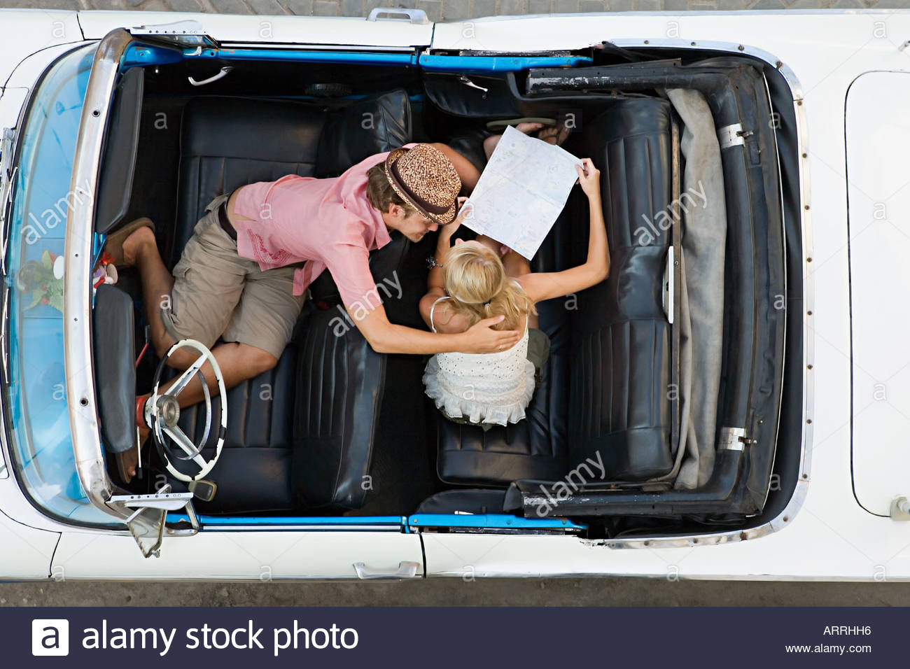 Couple looking at map in car Photo Stock