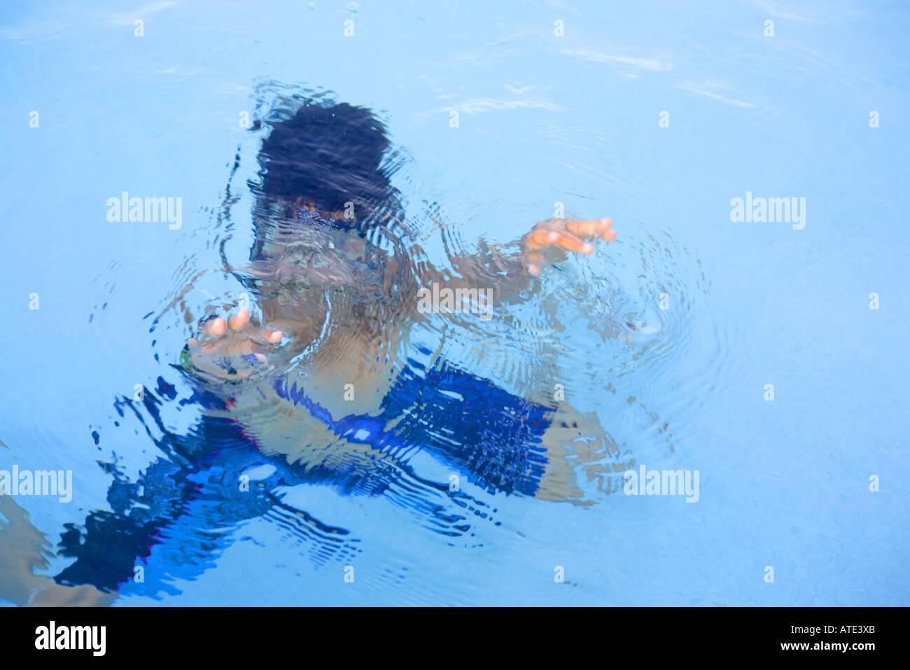 Asian boy swimming Photo Stock