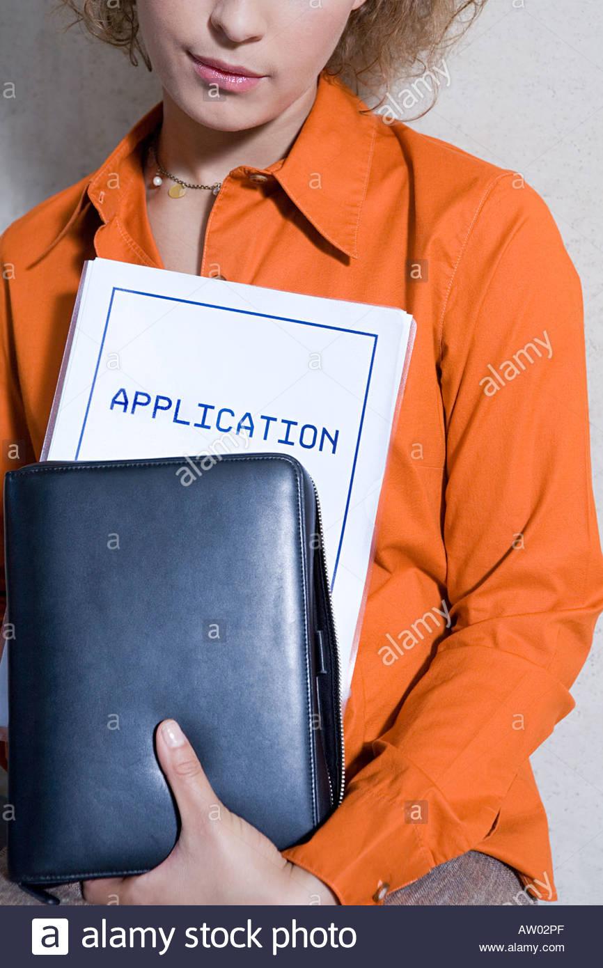 Formulaire de demande avec des femmes Photo Stock