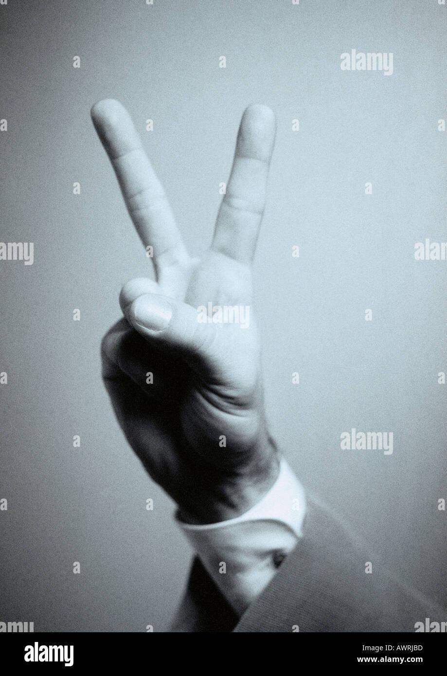 Part faire la paix signe, close-up Photo Stock