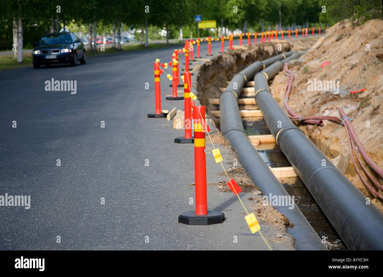 Site de construction de pipelines de chauffage urbain , Finlande Banque D'Images