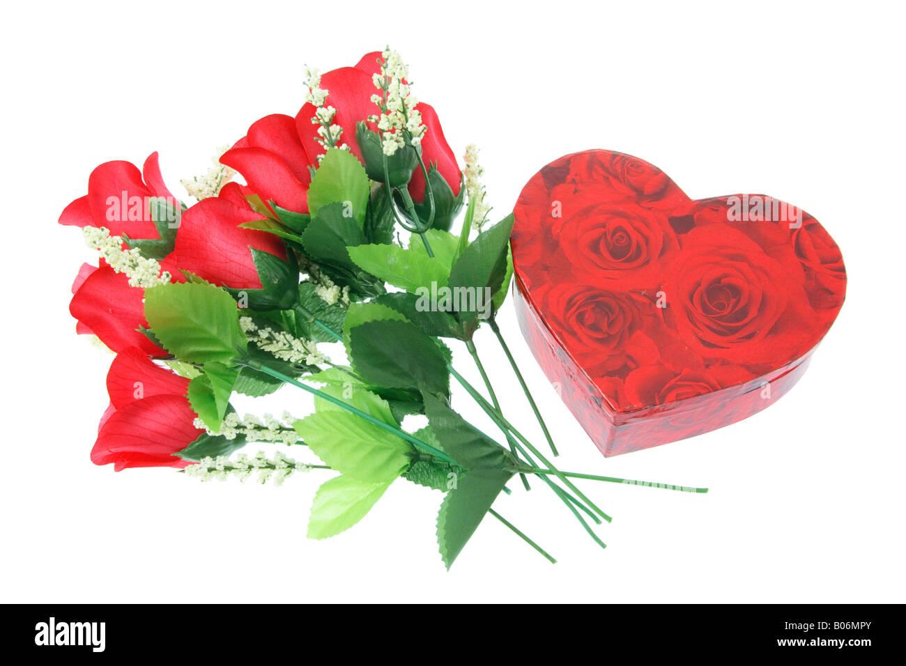 Roses rouges et boîte-cadeau Photo Stock
