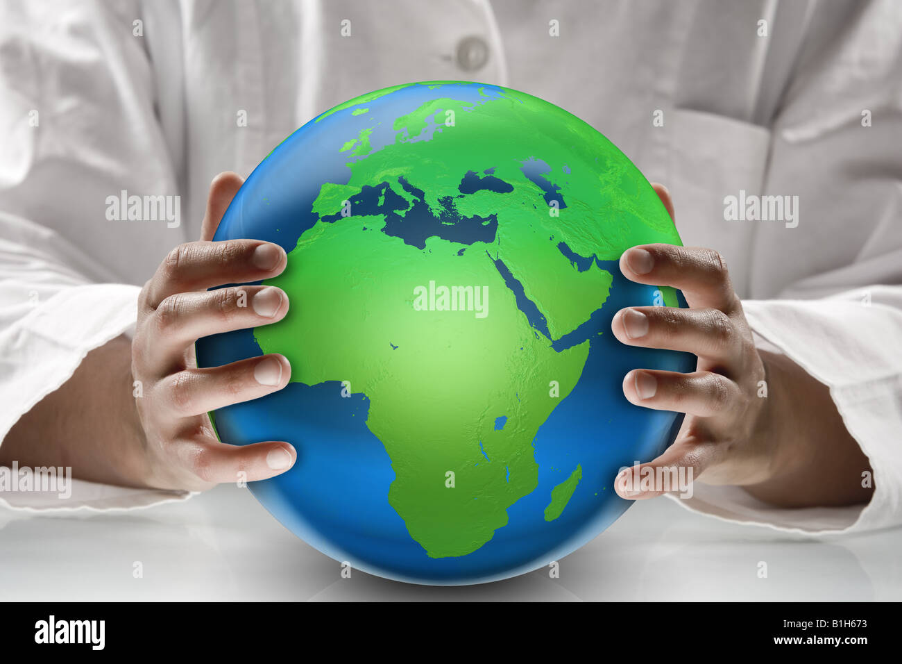 Scientist holding a globe Photo Stock