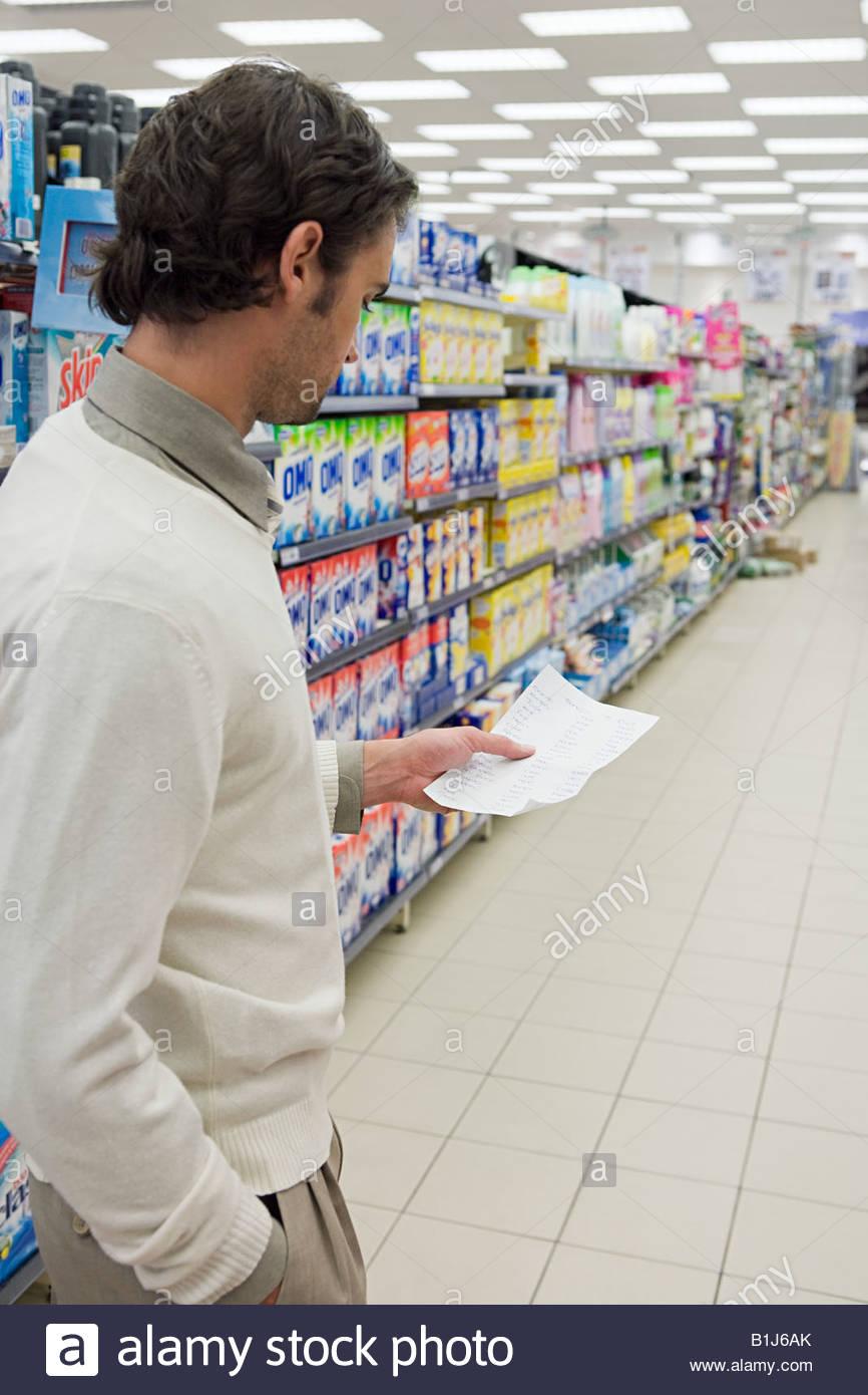 Man in supermarket Photo Stock