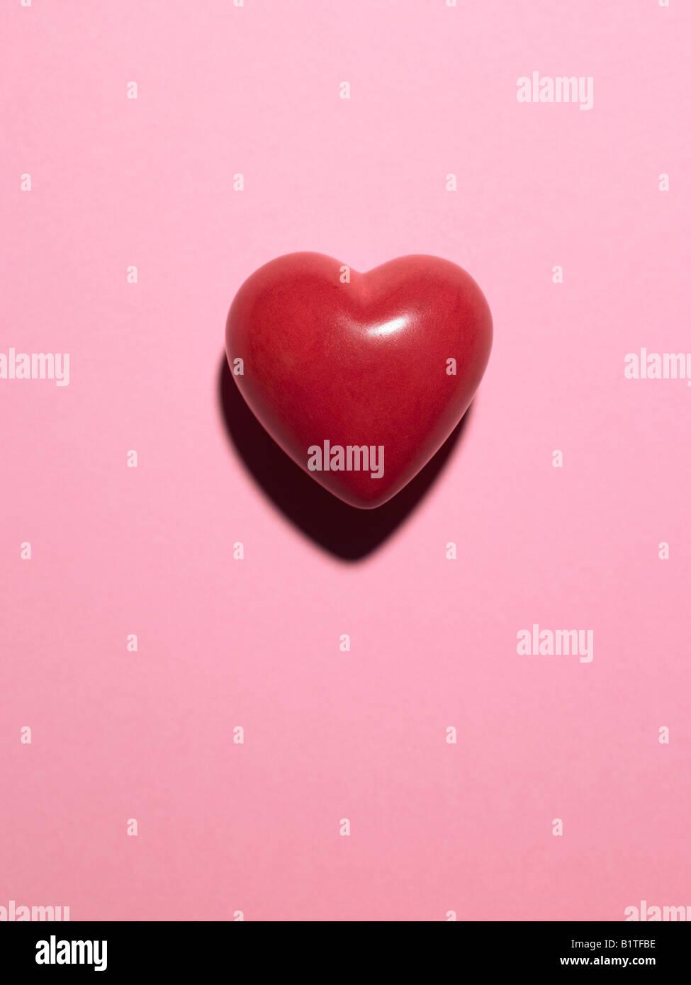 Coeur modèle sur fond rose Photo Stock
