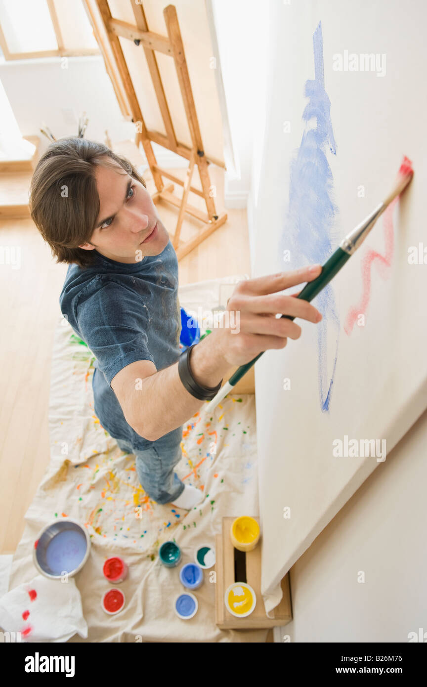 Man painting on easel Photo Stock